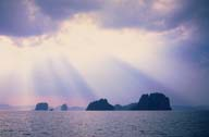 A picture of the sun streaming through clous On the Andaman Sea; near Krabi, Thailand