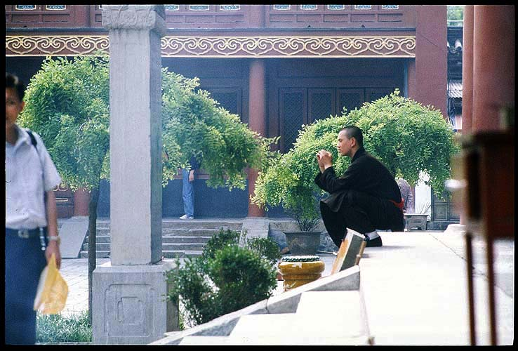 A monk in repose at Yonghe Gong<br>The Lama Temple  :: Beijing, China: The Lama Temple, Beijing, People's Republic of China : Temples; People You Meet.