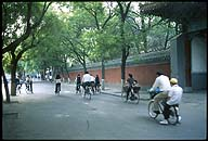 Cycling past the front gate ::  :: Kong Miao--The Confucius Temple :: Beijing, China