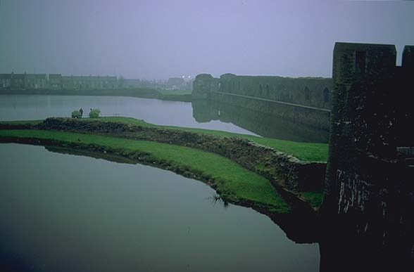 A Welsh Castle<br>Caerphilly, Wales.: Caerphilly, Wales, United Kingdom : Ruins and Restorations; Lakes.