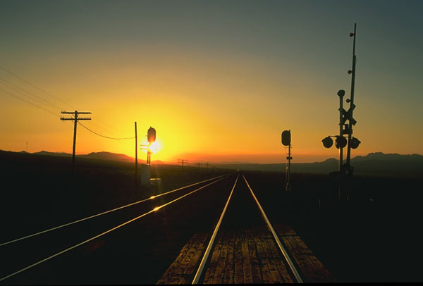 Rail Crossing<br>Nearing Ludlow, California: The Mojave Desert, California, United States of America : Landscapes; Engineering Feats.