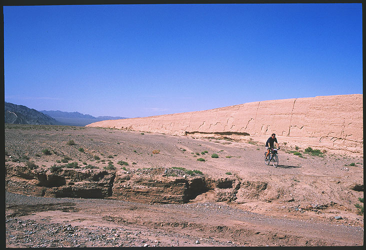 Jiayuguan :: Protecting the Ming Dynasty's Westernmost Extreme<br>Emma cycling on the Barbarian side<br>of the Ming Great Wall: Jiayuguan, Gansu, People's Republic of China : Great Wall; People You Meet.