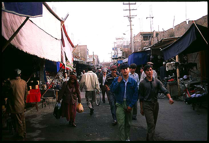 In the streets of the old town<br><br>Kashgar :: Xinjiang, China: Kashgar, Xinjiang, People's Republic of China : City Scenes; Crowds.