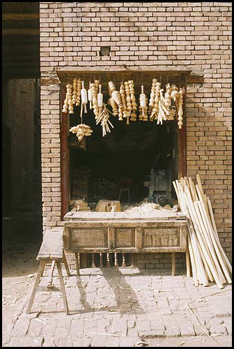 Lathe work<br><br>Kashgar :: Xinjiang, China: Kashgar, Xinjiang, People's Republic of China : Food Stalls and Markets.