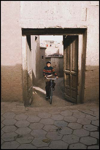 Cycling the side roads<br><br>Kashgar :: Xinjiang, China: Kashgar, Xinjiang, People's Republic of China : People You Meet; City Scenes.