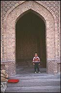 Boy in the Doorway ::  :: Kashgar :: Xinjiang, China