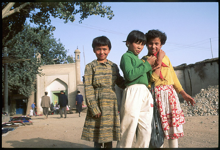 Three little Uyghur girls.<br>Kuqa :: Xinjiang, China: Kuqa, Xinjiang, People's Republic of China : People You Meet.