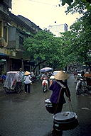 Rain quiets the busy streets :: Hanoi, Vietnam