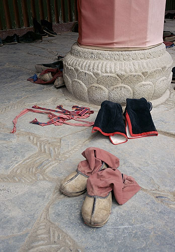 More boots.<p>Labrang Si, Xiahe<br>Gansu Province, China: Xiahe -- Labrang Si, Gansu, People's Republic of China : Temples; Buildings.