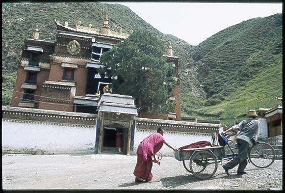 I get by with a little help from the monks.: Xiahe -- Labrang Si, Gansu, People's Republic of China : People You Meet; Spoke and Saddle attractions.
