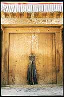 Doorway and prayer shawls.